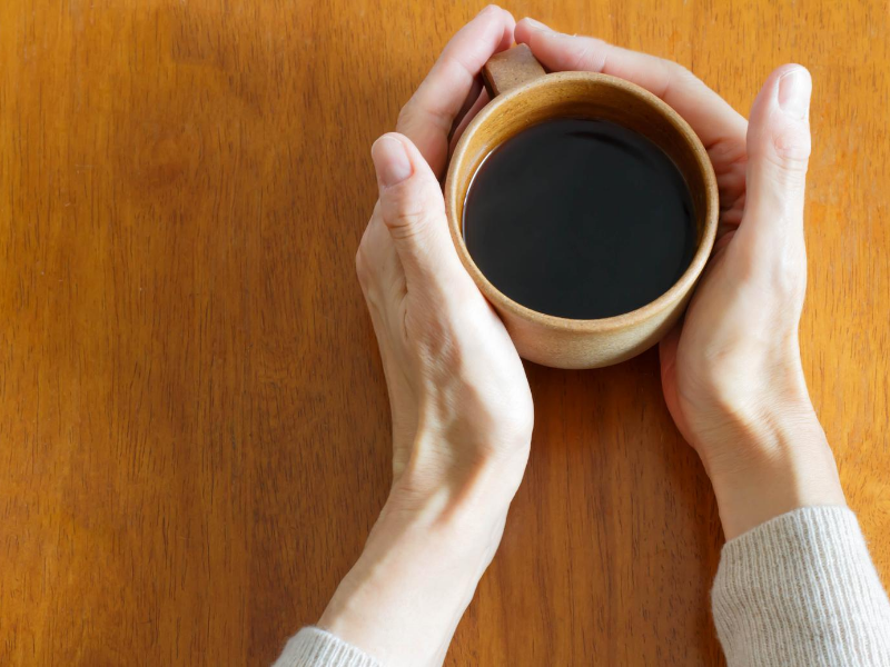 Warming hands on coffee mug