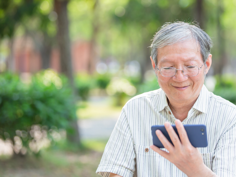Older adult looking at smartphone.