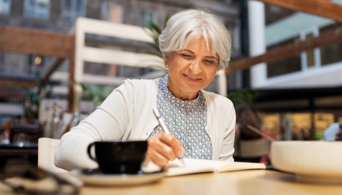 senior woman journals as form of self care