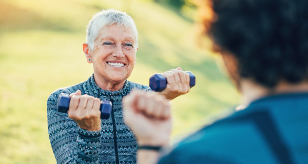 Senior woman strength training with dumb bells